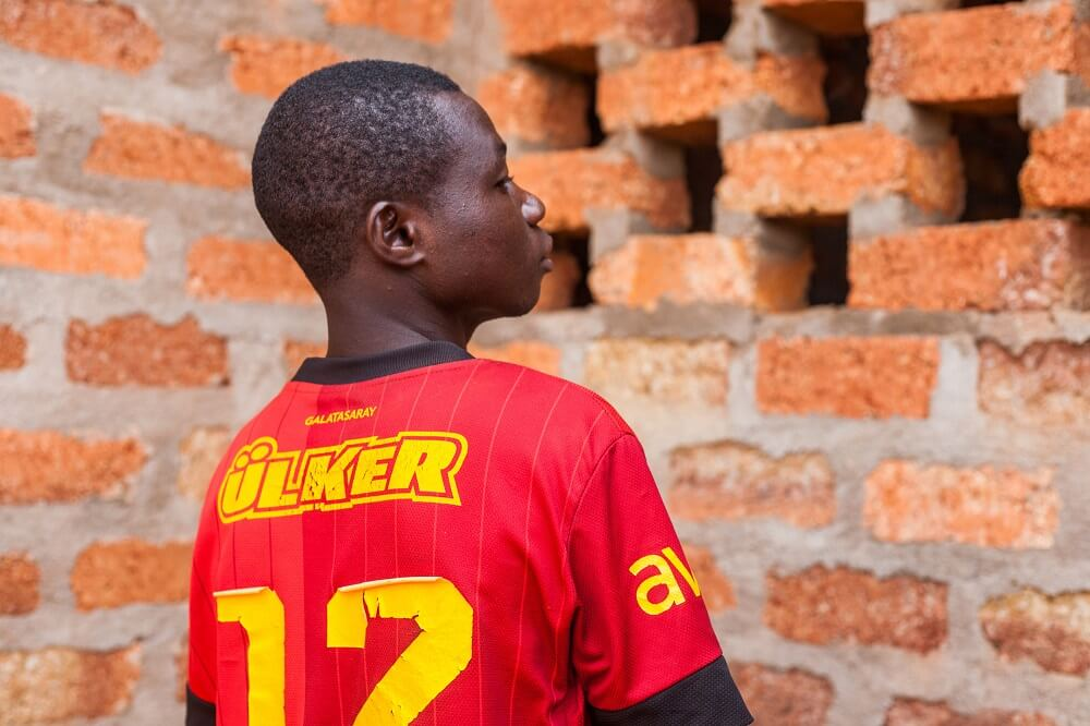 16-year-old Lester* is one of the children receiving training to become a tailer at the rehabilitation centre in Bangui
