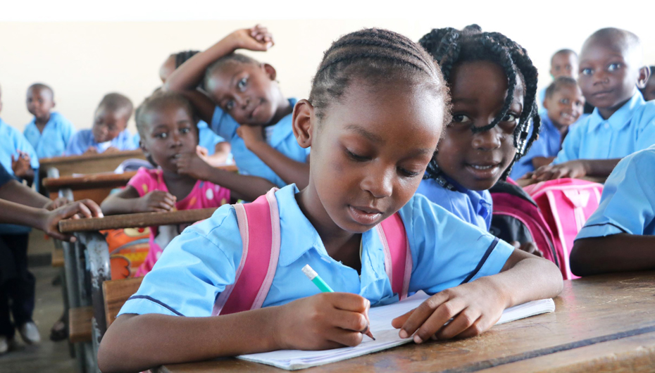 Girl learning in newly refurbished classroom in Beira
