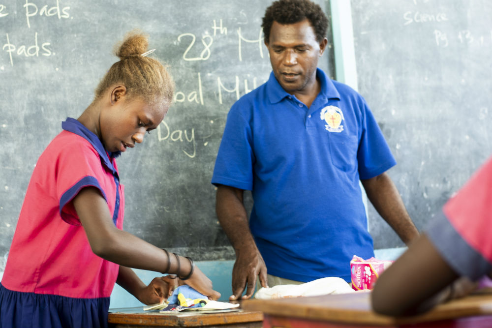Mr Matia, the school headmaster with a student